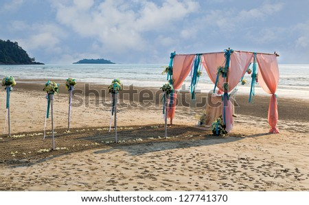 Flower decoration at the beach wedding venue - stock photo
