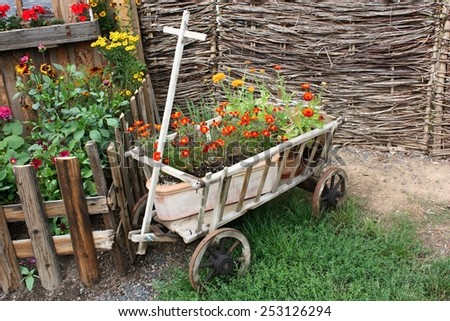 Flower decoration in a wooden cart - stock photo