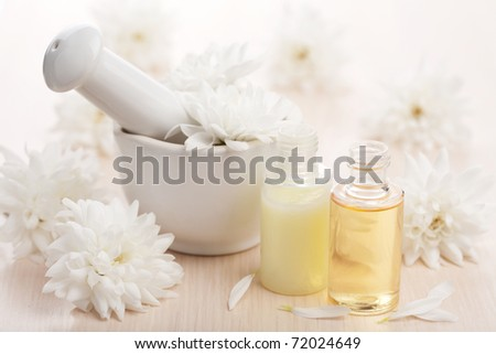 flower essential oil and mortar - stock photo