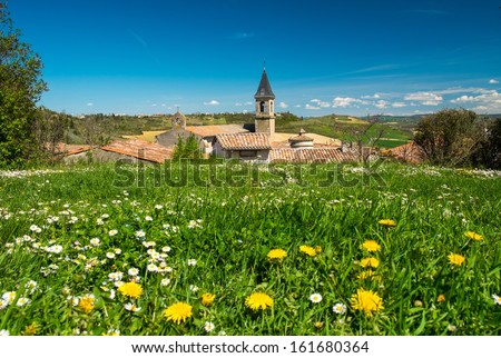 Flower field in front of Lautrec village, France  - stock photo
