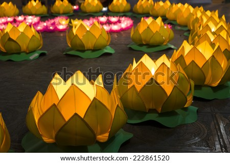 Flower garlands and colored lanterns for celebrating Buddha's birthday in Eastern culture. They are made from cut paper and candle - stock photo