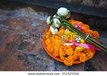 Flower garlands in a temple - stock photo