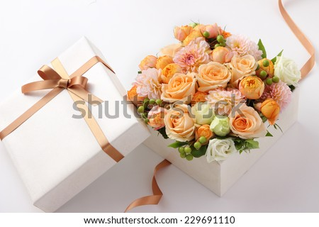 flower gift on a white background - stock photo