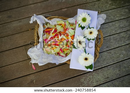 Flower girl basket of petals. - stock photo