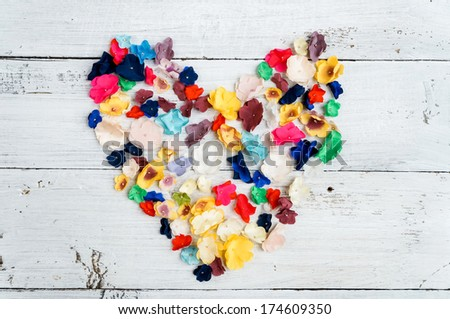 flower heart over white wooden background - stock photo