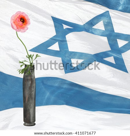Flower in the cartridge case with Israeli national flag in blur background. Revival