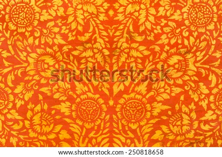 flower in traditional Thai style painting on antique preaching cabinet in church of buddhism at Wat Phra Borommathat, Tak, Thailand. - stock photo