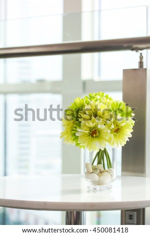 flower in vase on marble table