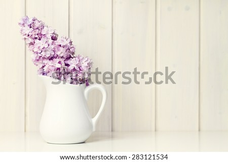 flower in white vase greeting card background
