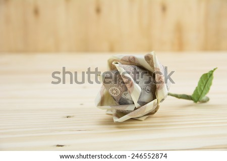 flower made from Thailand Ten Baht Banknote which is not currently in use , banknote collection on wood background,concept valentine - stock photo