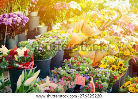 Flower market with various multicolored fresh flowers - stock photo