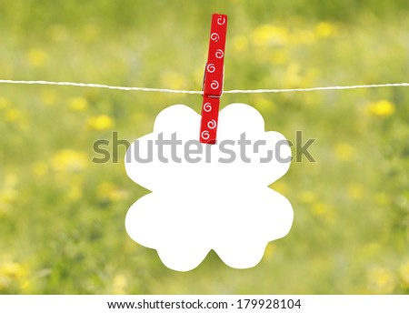 Flower note on a rope with peg - stock photo