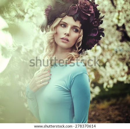 Flower nymph in a spring orchard - stock photo