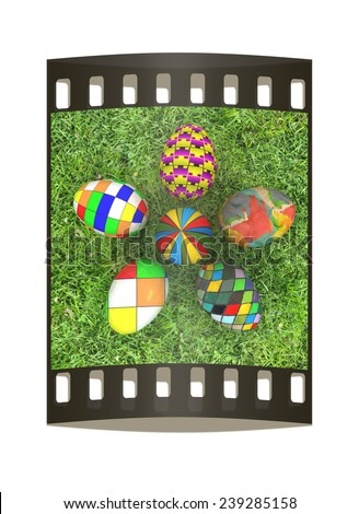 Flower of Easter eggs on the grass. The film strip with place for your text - stock photo