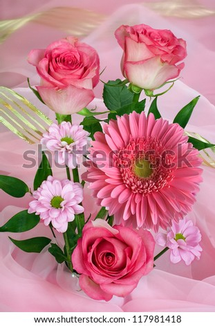 Flower of  pink roses and gerber daisy  on pink - stock photo