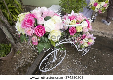 flower on a bicycle background lawn - stock photo