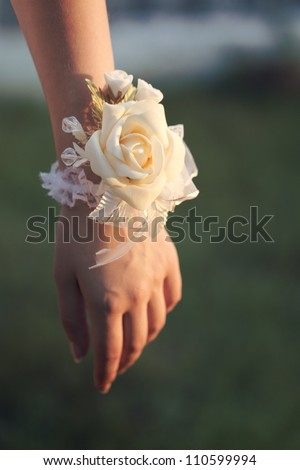 Flower on hand of the bridesmaids at the wedding - stock photo