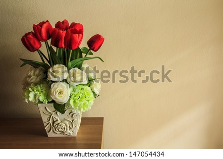 Flower on wooden table with softly sunshine