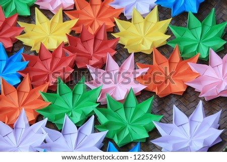 Flower origami on bamboo tray - stock photo