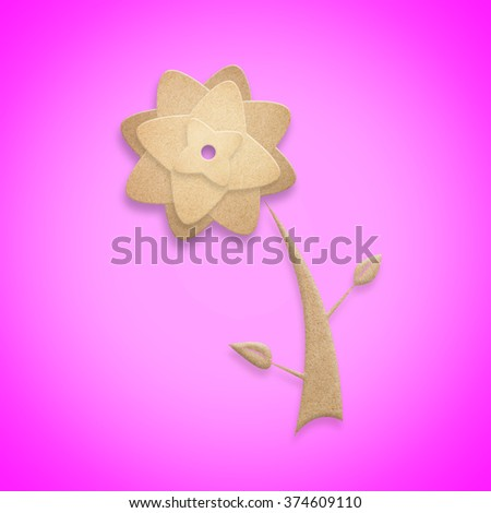 Flower origami recycled paper craft stick on a pink background. - stock photo