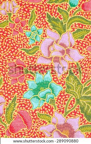 flower pattern background on batik fabric thai style. - stock photo