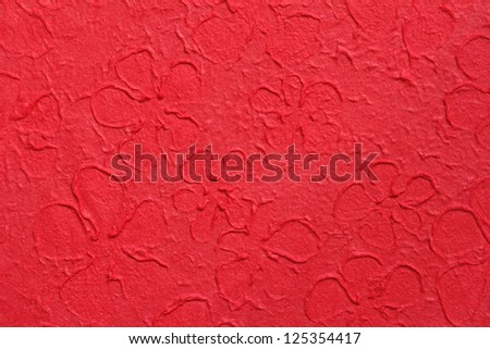 flower pattern on red mulberry paper closeup