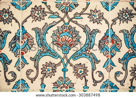 Flower patterns on ceramic tiles in the old Turkish style, 15th century Topkapi Palace in Istanbul, Turkey. - stock photo