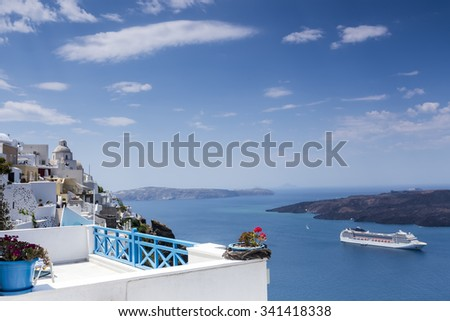 Flower pot in front of the ocean in Santorini