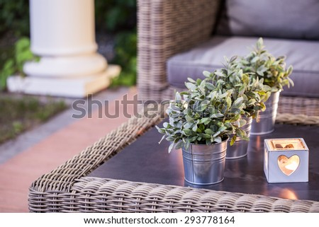 Flower pots and tealight on the table - stock photo