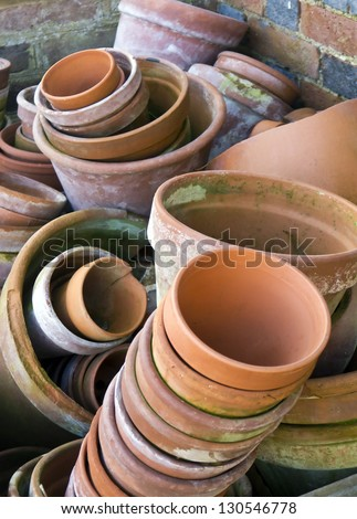 Flower pots; random piles and stacks of vintage flowerpots - stock photo