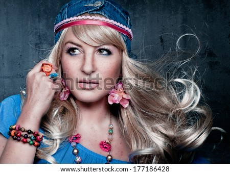 flower power girl with wind in hair - stock photo