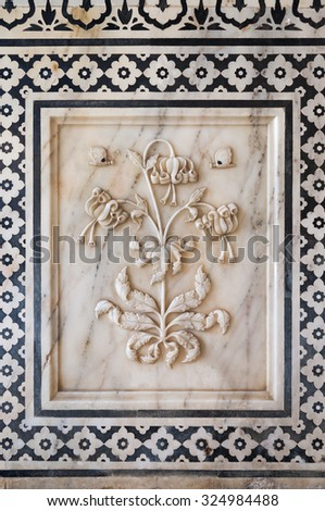 Flower relief on marble indian decoration - stock photo