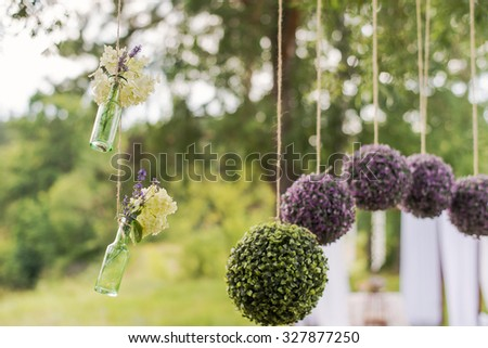 Flower round compositions for wedding decor. Glass hanging bottles for flowers. - stock photo