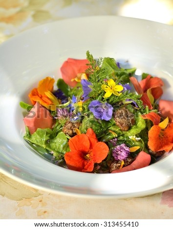 Flower salad in a white plate - stock photo