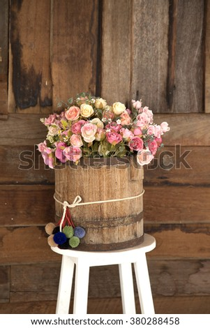 Flower standing on a chair - stock photo