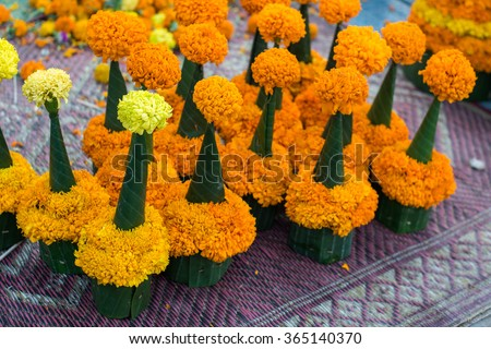 Flower Stupa for sale to tourist that prayer offering at the Temple in Luang Prabang, Laos. Traditional object in Asia Style - stock photo