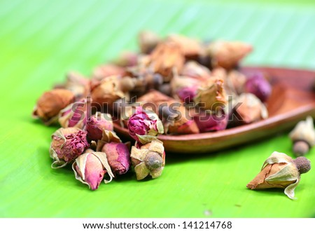 Flower tea rose buds on banana leaves
