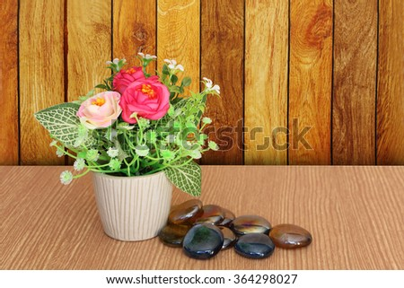flower vase and marble stone with wooden wall background