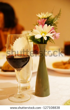 Flower vase and wine in party - stock photo