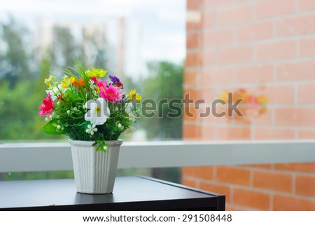 flower vase near the glass window