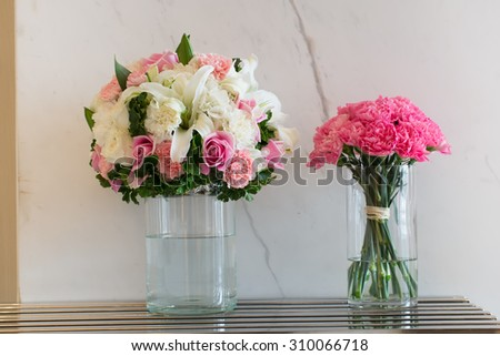 Flower vase on table
