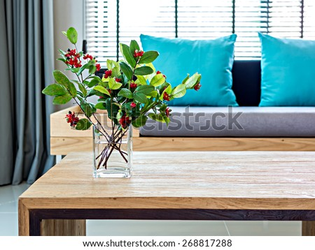 Flower vase on table top with sofa background/ modern interior Living room - stock photo