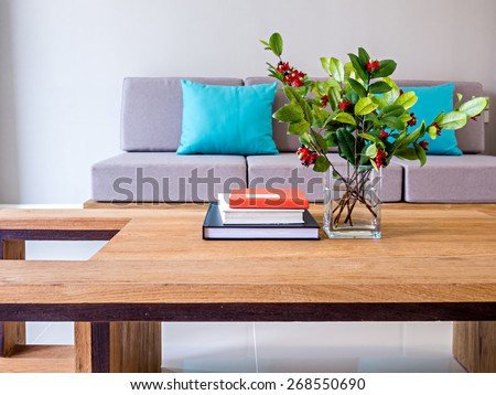 Flower vase on table-top with sofa/ minimalist modern interior Living room