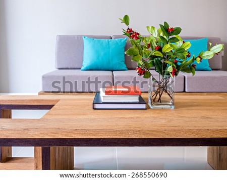 Flower vase on table-top with sofa/ minimalist modern interior Living room - stock photo