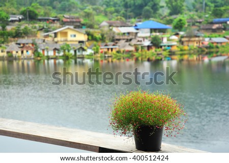 Flower Vase on The  Bench at Riverside - stock photo