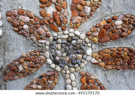 Flower - wall decorations made of rocks in Ivan Dolac village, Croatia