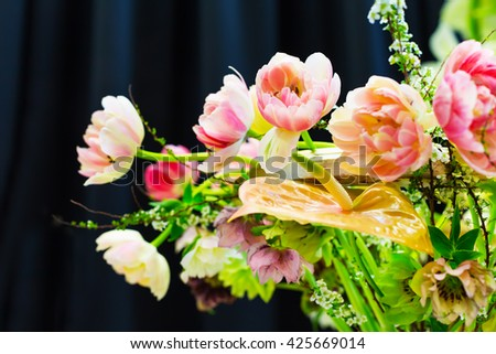 Flower wedding holiday decoration, beautiful pink roses peony blooming bouquet on black background - stock photo