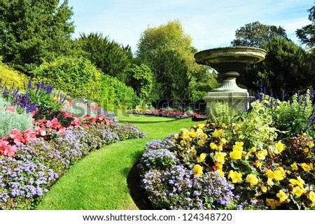 Flowerbeds in a Peaceful Formal Garden - stock photo