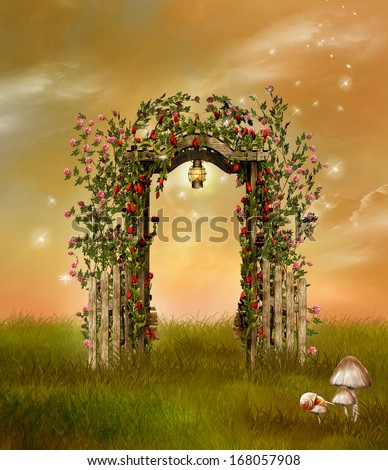 Flowered fence with lantern in a garden - stock photo