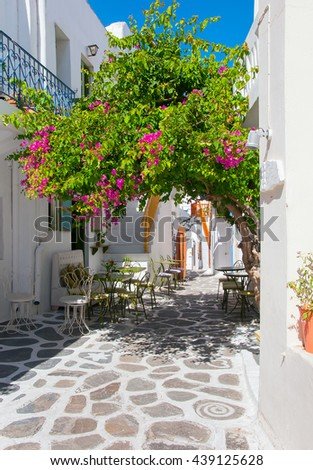 Flowering bougainvillea at restaurant in the town of Mediterranean Sea - stock photo